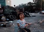 Girl in Shopping Cart, 1989