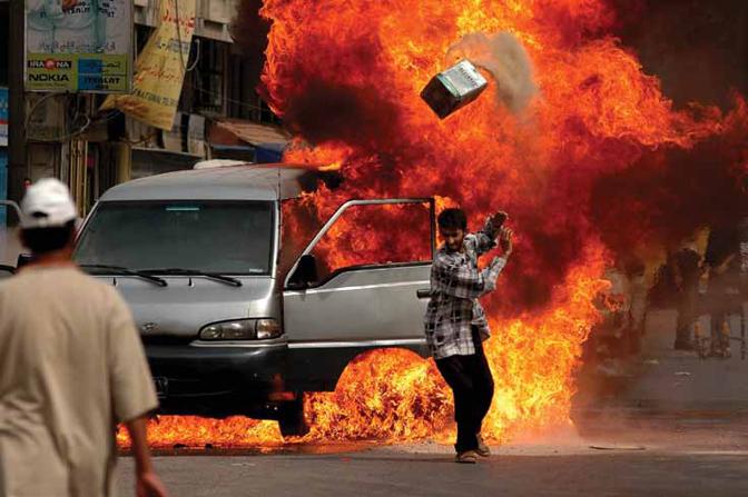 Ashley GilbertsonIraqi's attempt to extinguish a van that caught fire on Saadoun Street in Baghdad, Iraq on May 30, 2004