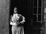 Thumbnail image: A Woman Waiting In The Doorway, Harlem, 1976