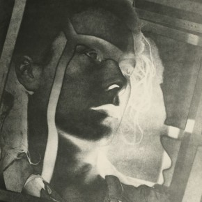 solarized woman's face in cage