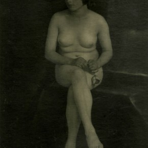 image of seated nude woman holding a rose