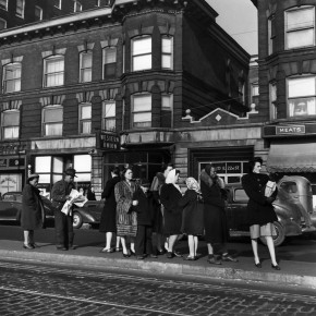 line of people on the street waiting for a trolley
