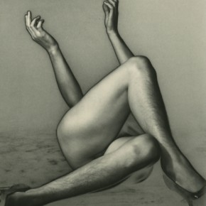 nude person in heels lying down with their legs crossed and hands in the air