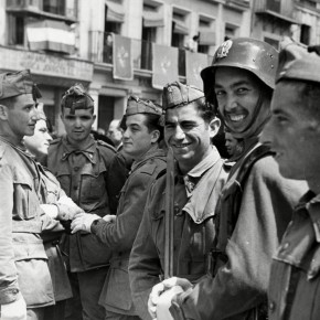 group of soldiers standing in the street, smiling