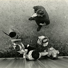 aerial view of man, woman and four children; one child is looking straight up